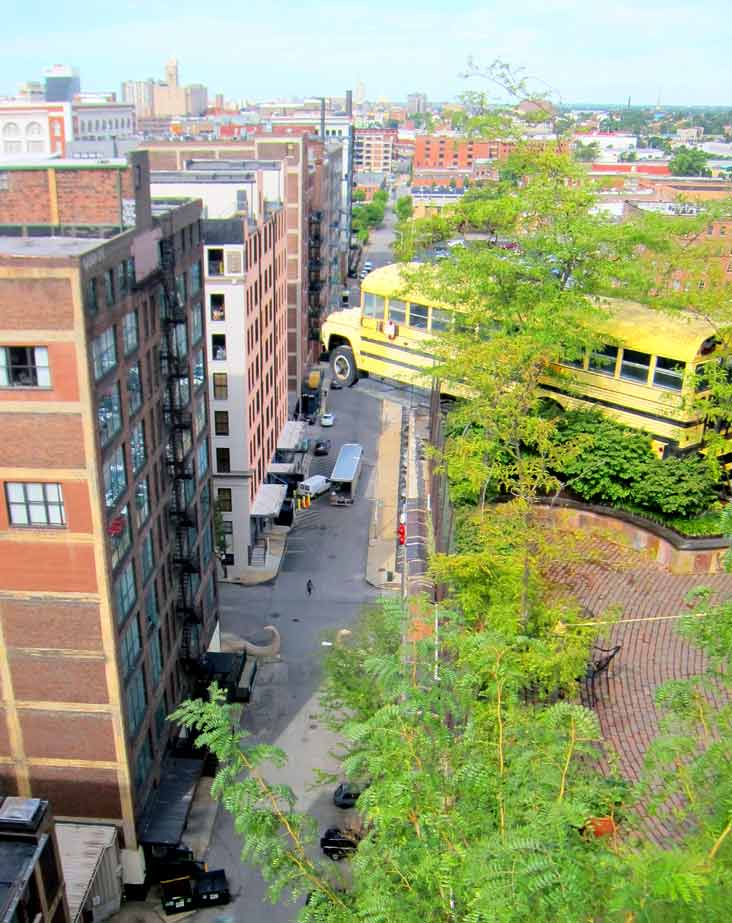 School bus about to fall of the roof of the City Museum, St. Louis. You can get inside too!