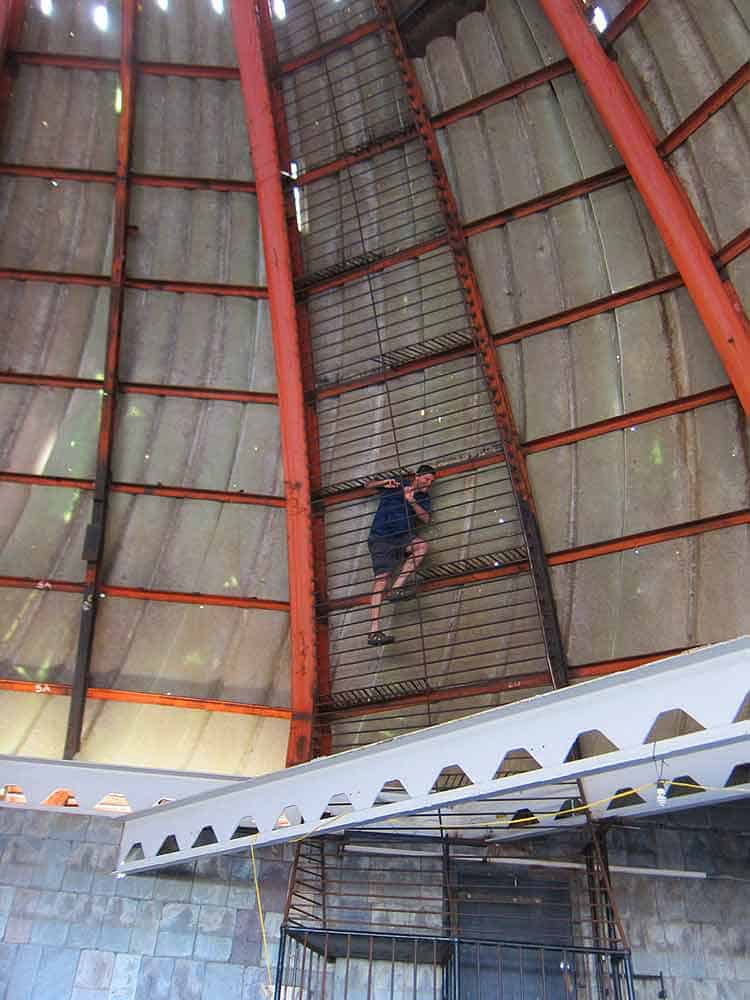 Climbing up the dome on the top of the rood of the City Museum