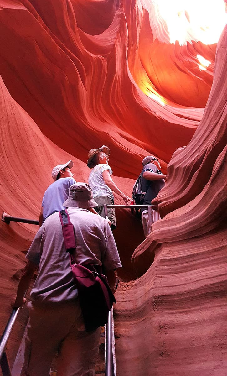 Climbing the steps at the lower Antelope Canyon