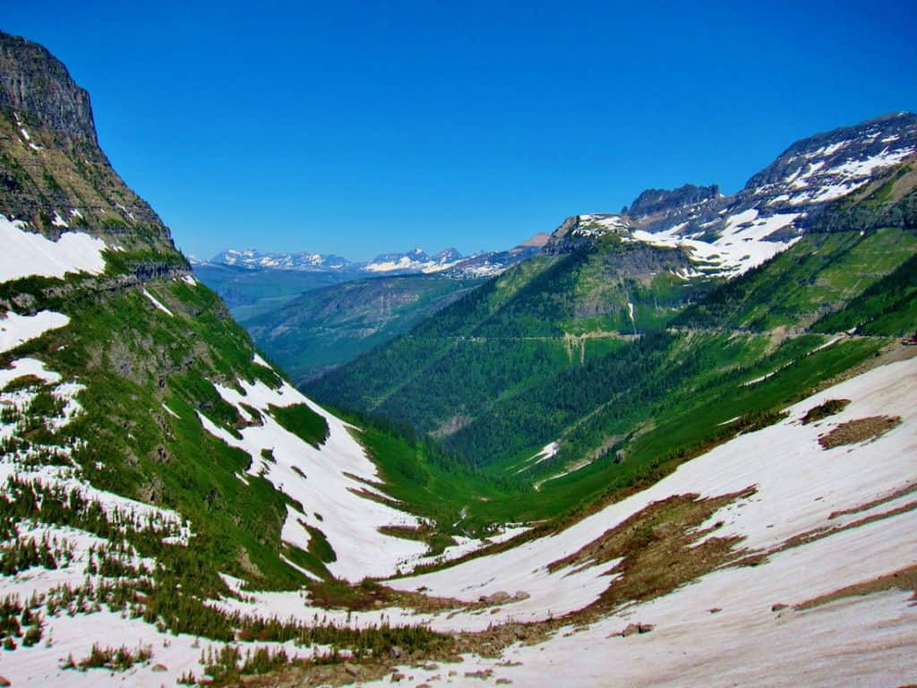 A view of the Going To The Sun Road that takes you across the Rockeis in the most beautiful mountain pass in America! Glacier National Park Itinerary: A complete and illustrated day-by-day itinerary for visiting the most beautiful national park in the US!
