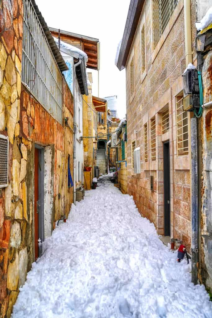 Snow in Jerusalem. It happens almost every winter so bring warm clothes!