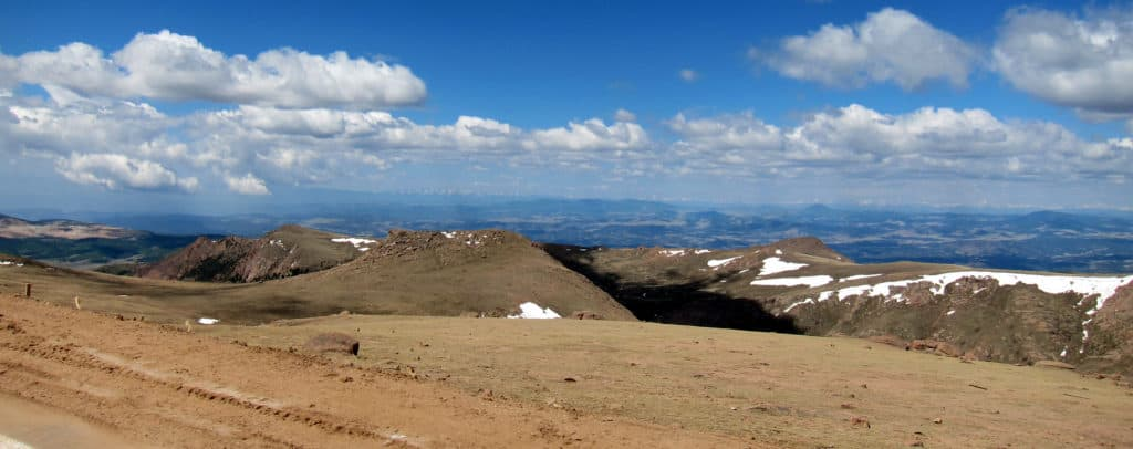 Stop to see the views while driving to the summit of Pikes Peak. Click to read more Visiting Pikes Peak: 7 things you need to know. We visited America's mountain and I have insights to share that will help make your trip to Pikes Peak in Colorado a safe and memorable experience.