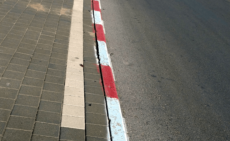 White and red curb in Israel - do not park here