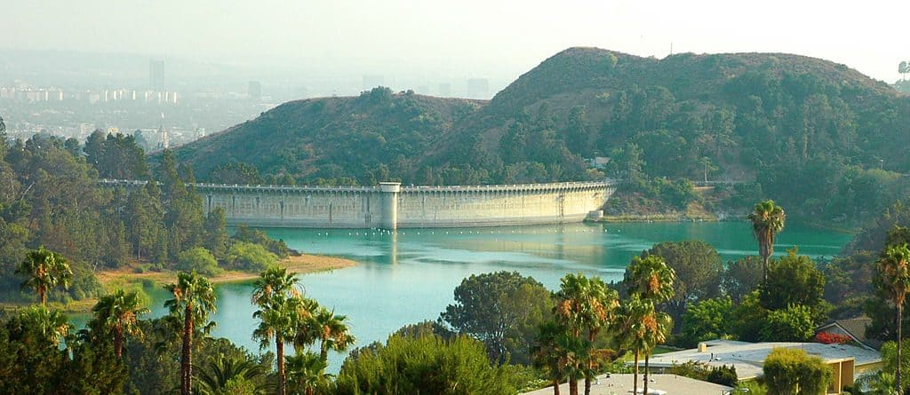 A view of Hollywood Reservoir and the back side of the Mulholland Dam — viewed from Canyon Lake Drive, Los Angeles, California.