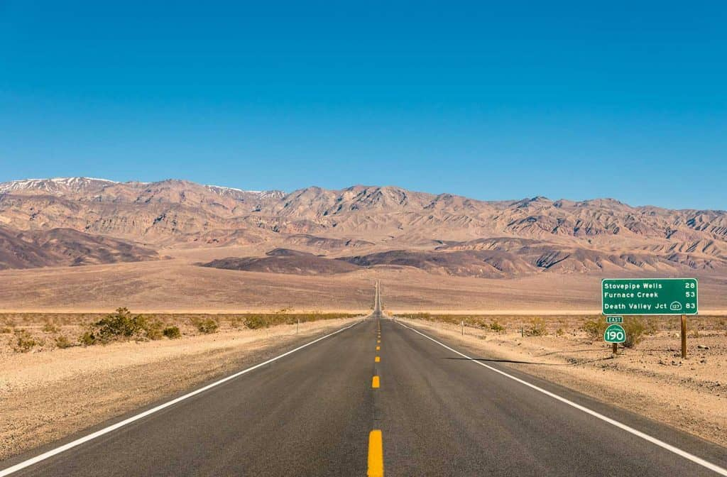 Empty infinite road in the desert of Death Valley California