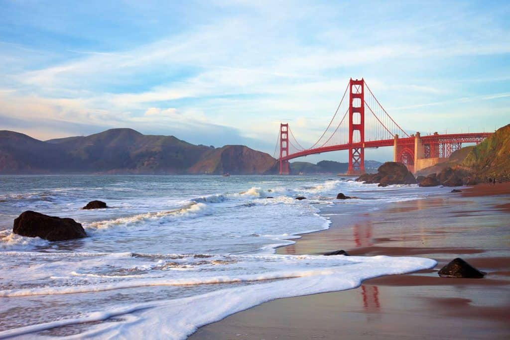 Golden Gate bridge at sunset seen from Marshall Beach, San Francisco