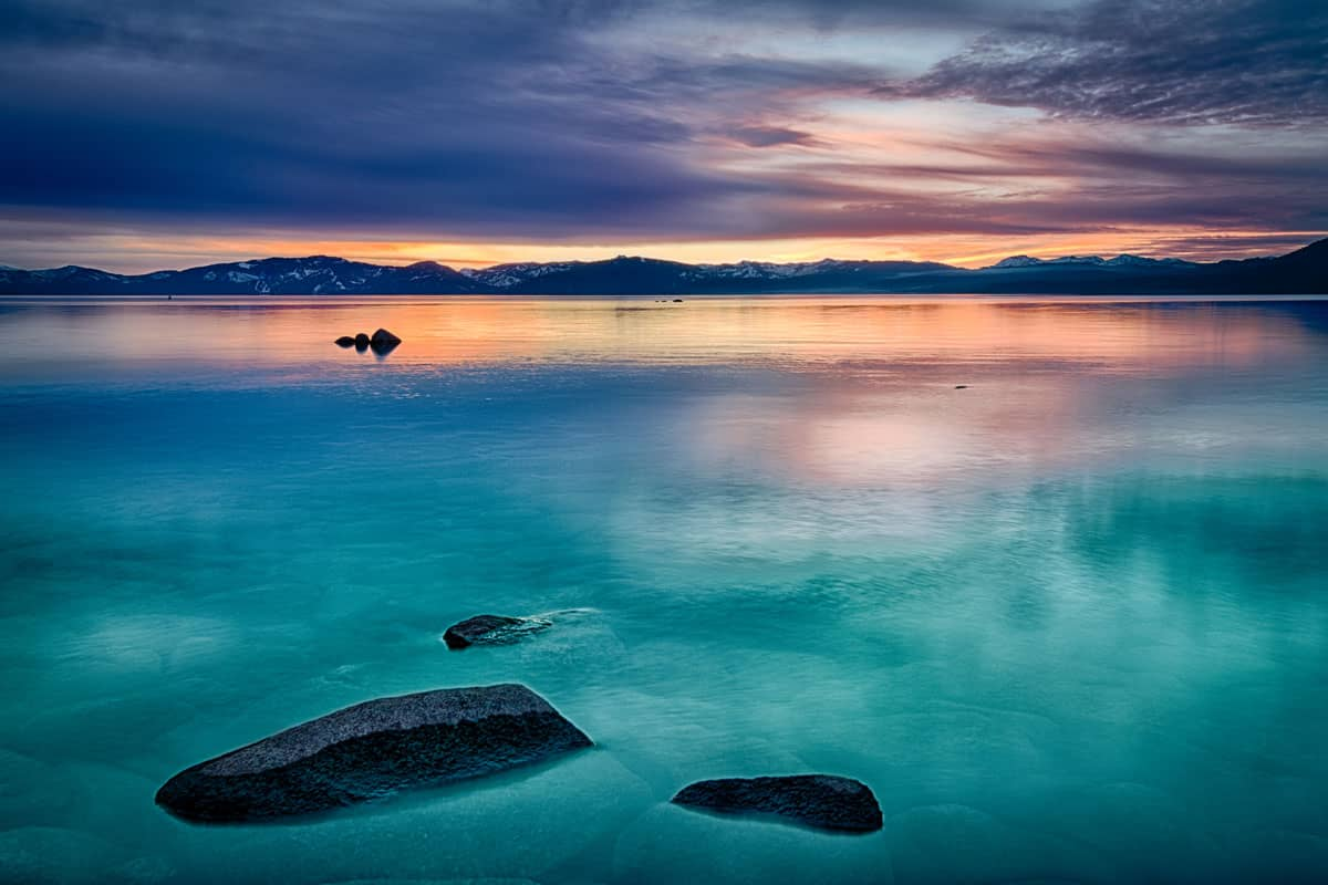 Reflection-of-clouds-in-a-lake,-Lake-Tahoe,-Sierra-Nevada,-California,-USA