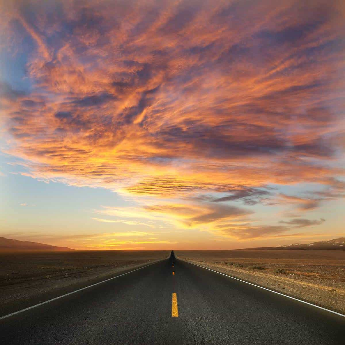 Road through Death Valley during sunset