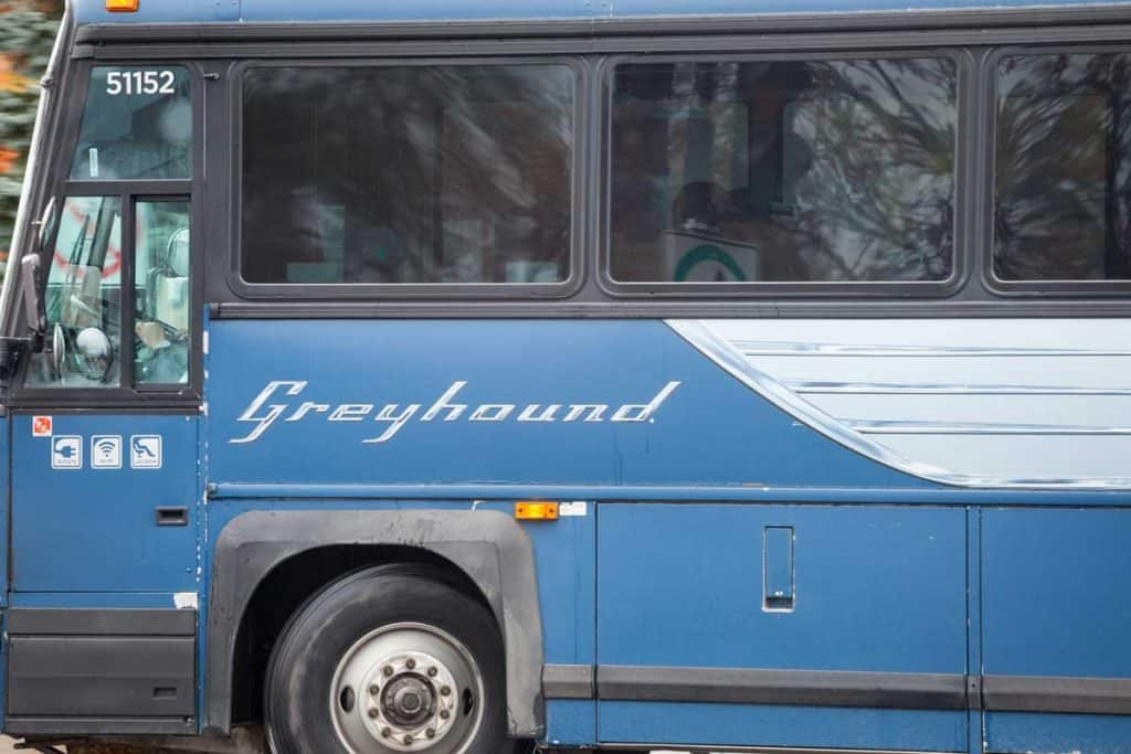 Greyhound bus leaving terminal