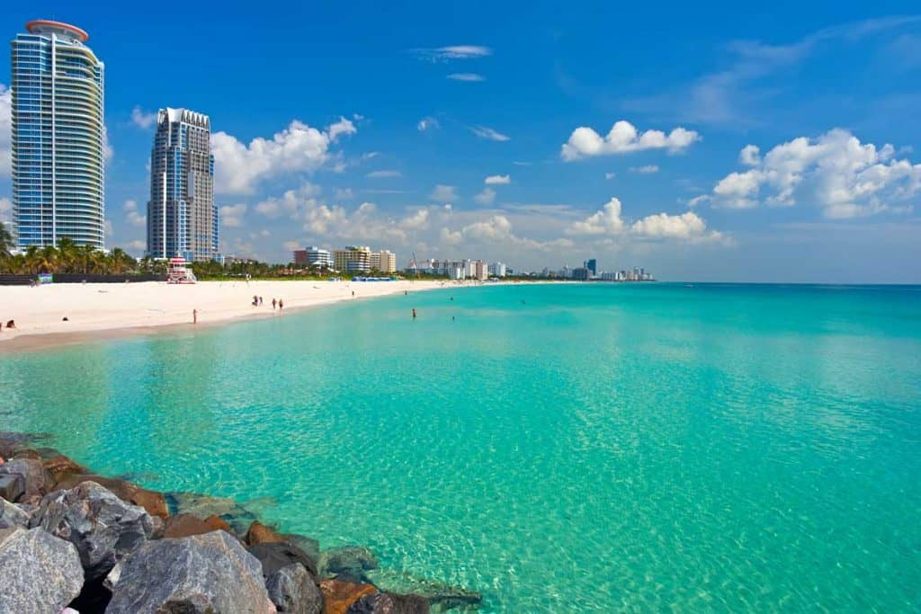 Beaches and tall buildings in Miami with clear blue oceans