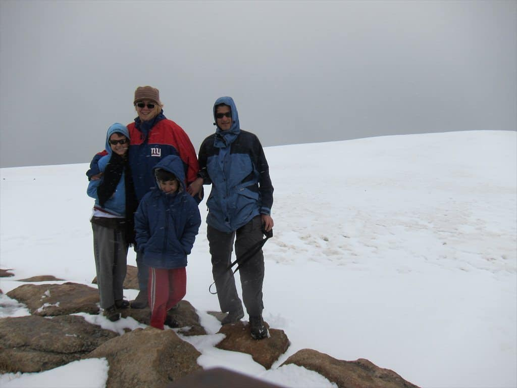Family wearing snow gear at Trail Ridge road