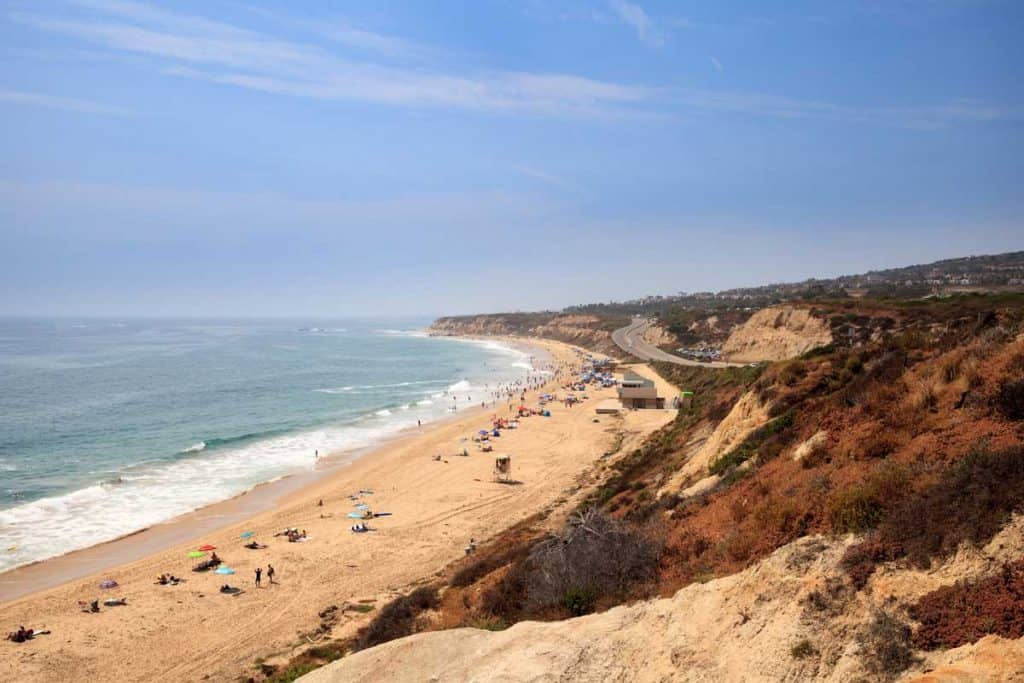 People doing outdoor beach activities on a sunny day at crystal cove state park