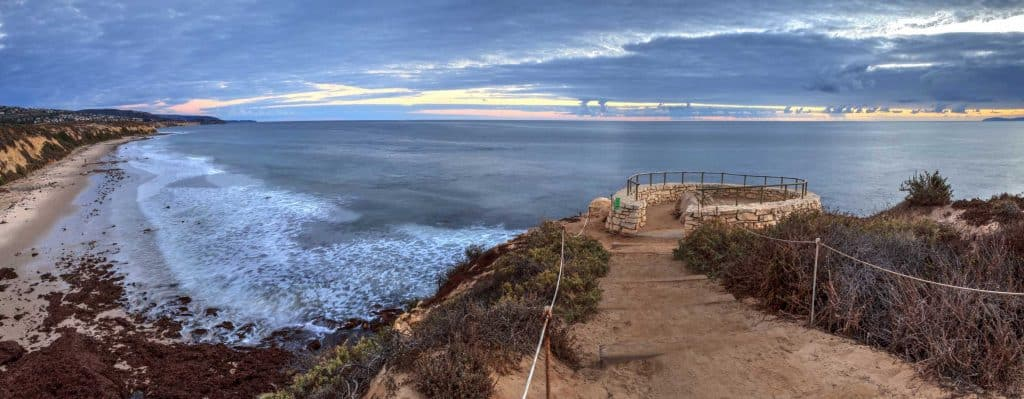 Huge waves making its way to the beach at dusk in Crystal Cove State Park, California