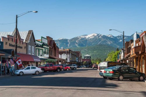 View of the main street of Whitefish, Montana with houses, stores, cars, 7 Awesome Things To Do In Whitefish, Montana
