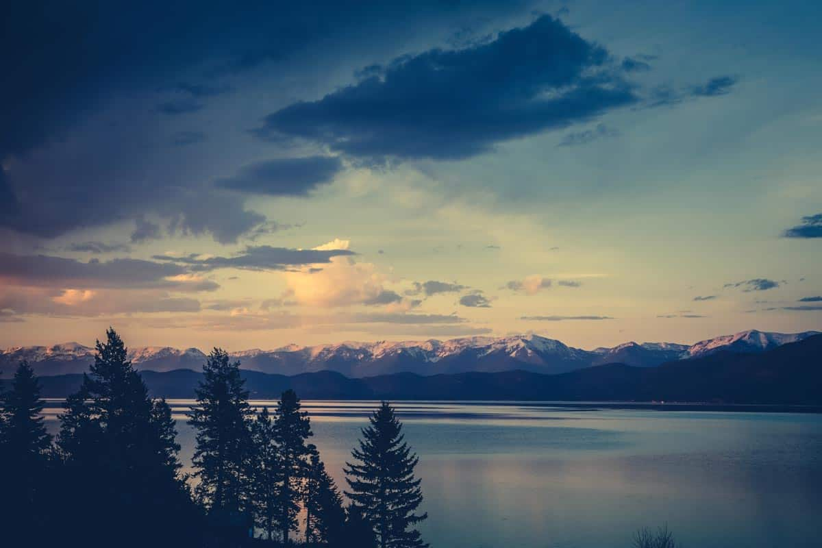Flathead lake photographed from a high elevation with mountains turning blue on the background