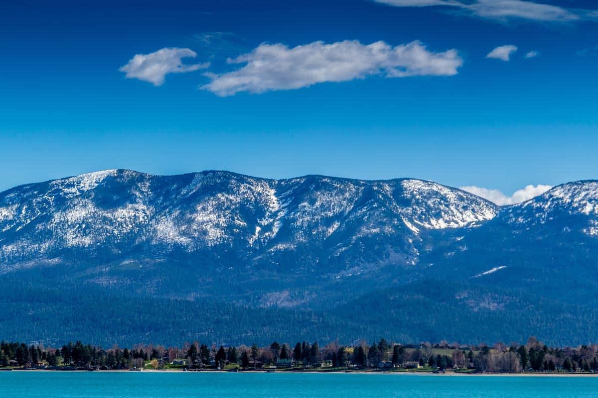 Huge mountains and crystal blue waters of Flathead lake, Montana