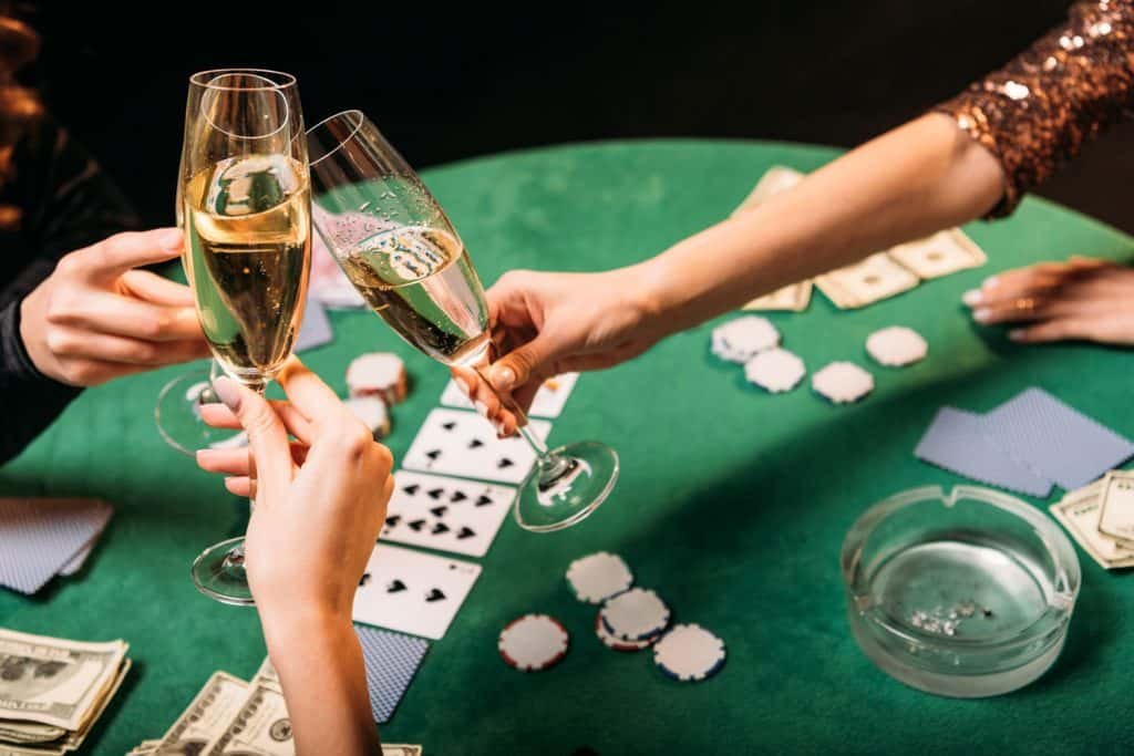 Poker players taking a toast with their champagne glasses