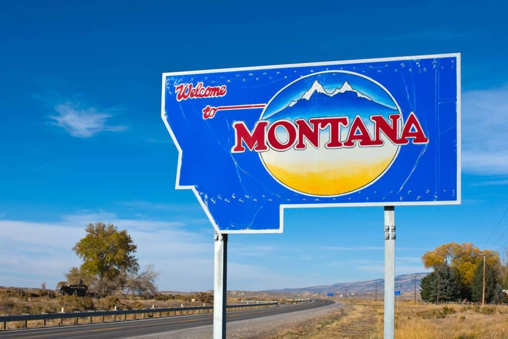 A Welcome to Montana sign on the side of the road