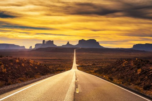 A long highway leading to Monument Valley photographed at sunset, How Much Does A Road Trip Across America Cost?
