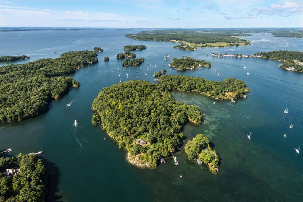 Aerial view of Thousand islands at Upstate New York with boats moving along the water