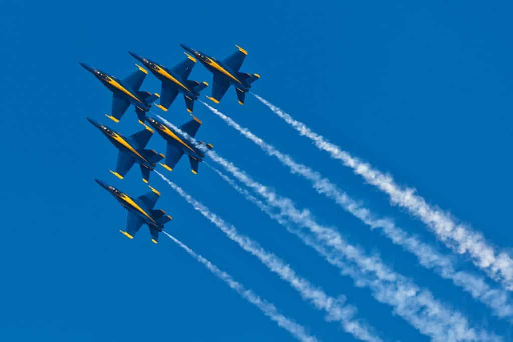 The United States Navy Blue Angels soaring above the sky doing some aerial performance