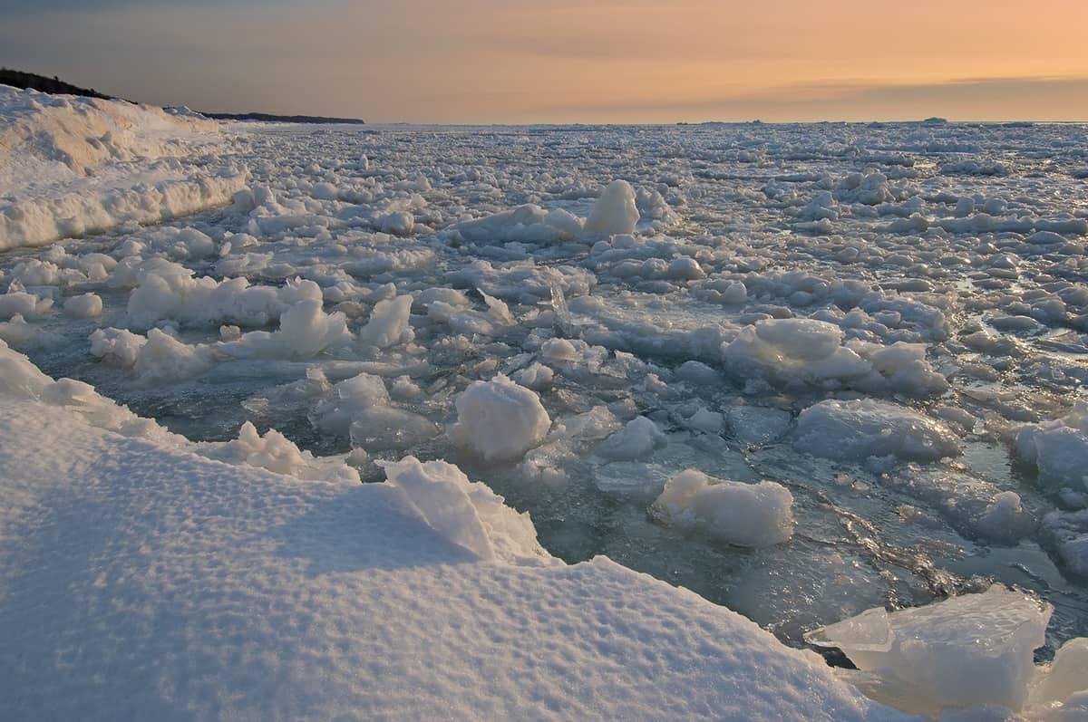 Winter landscape of the frozen shoreline of Lake Michigan near sunset